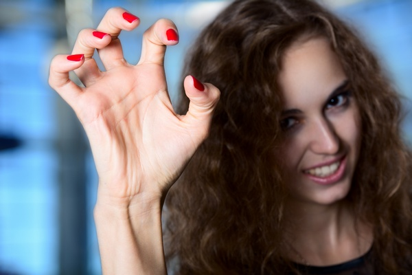 A girl with a terrible frightening hand, crooked fingers